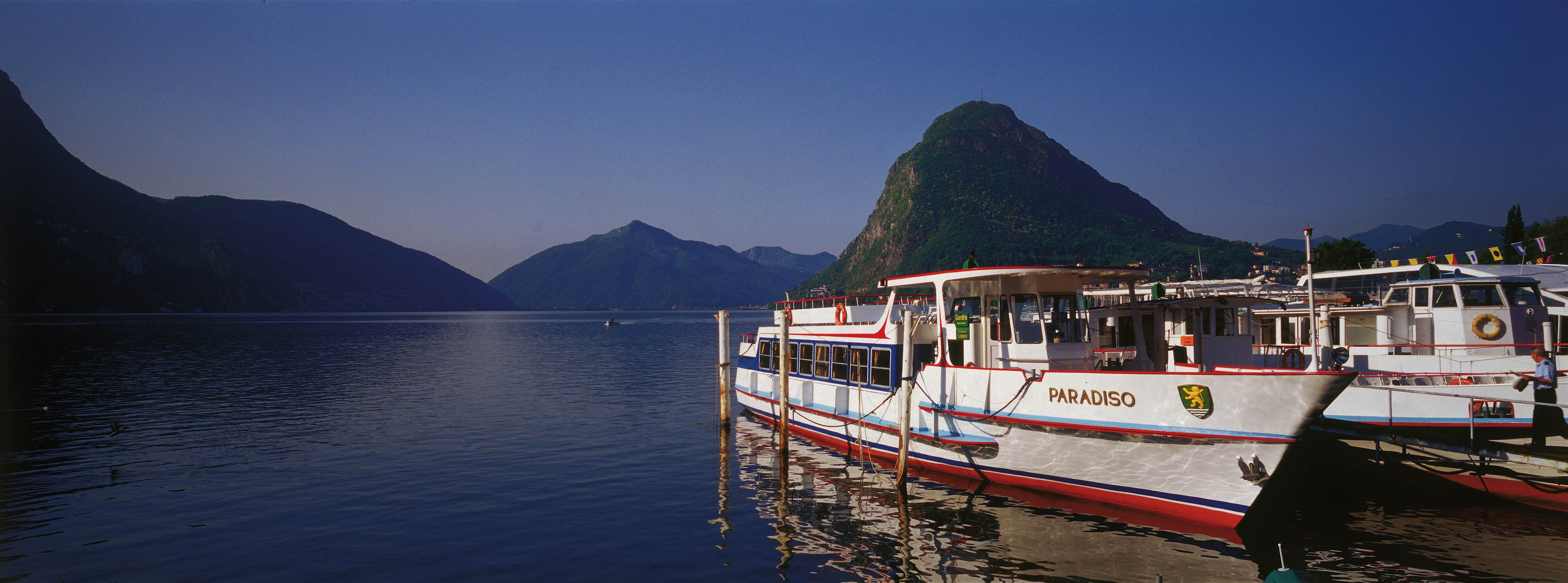 Boats on the Lugano lake in the evening