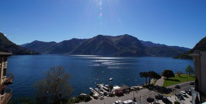Sunny balcony view to the Lugano lake
