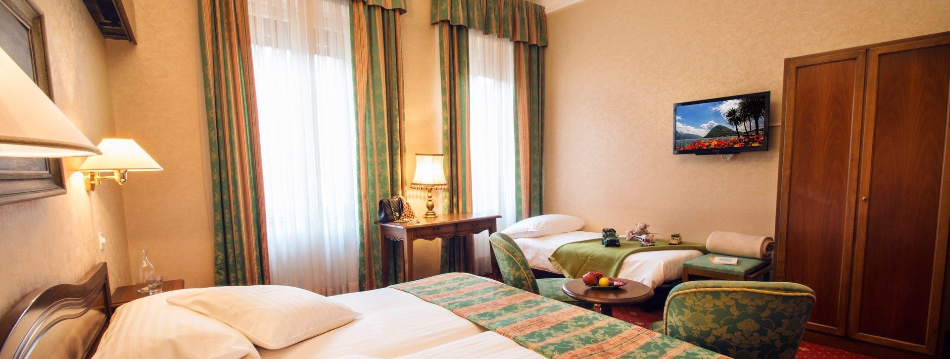 Triple room with three beds in the International au Lac Historic Lakeside Hotel