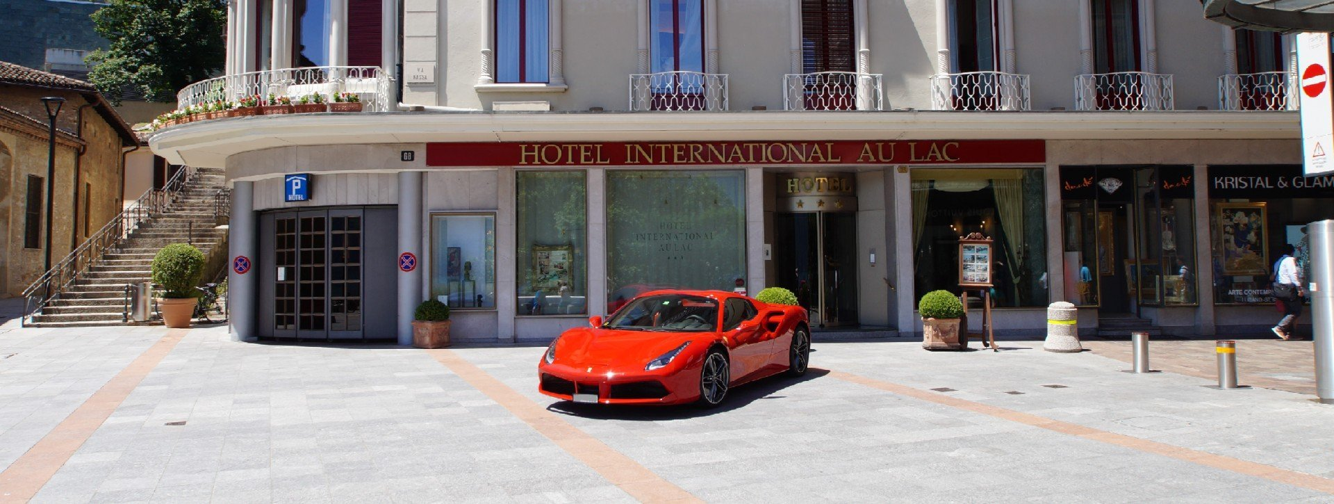 Red Ferrari in front of the International au Lac Historic Lakeside Hotel