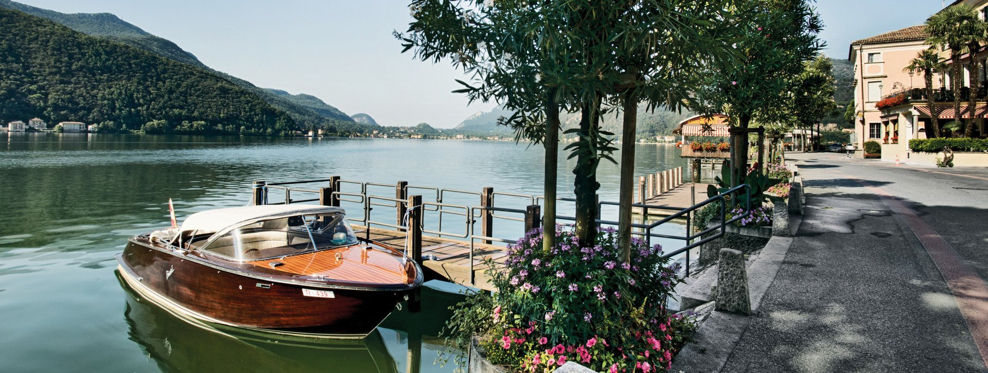 A wooden boat on the Lugano lake