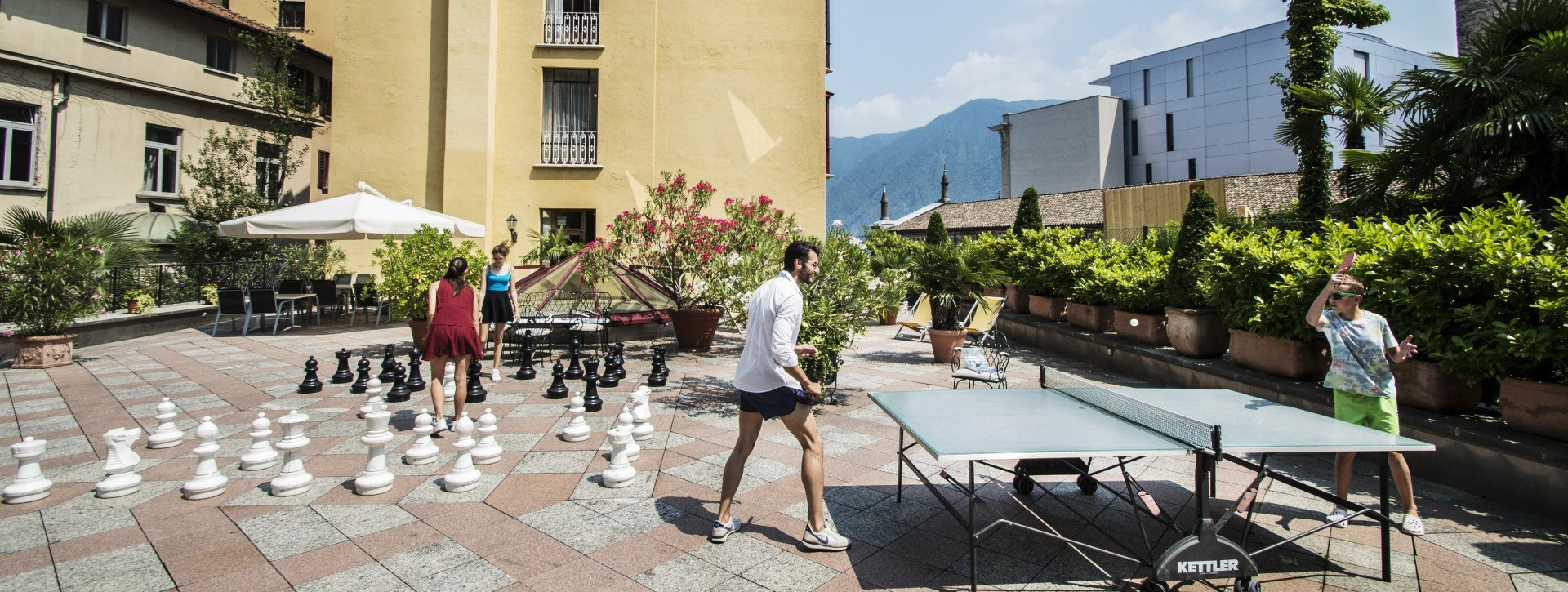 People play ping pong and chess at the hotels garden
