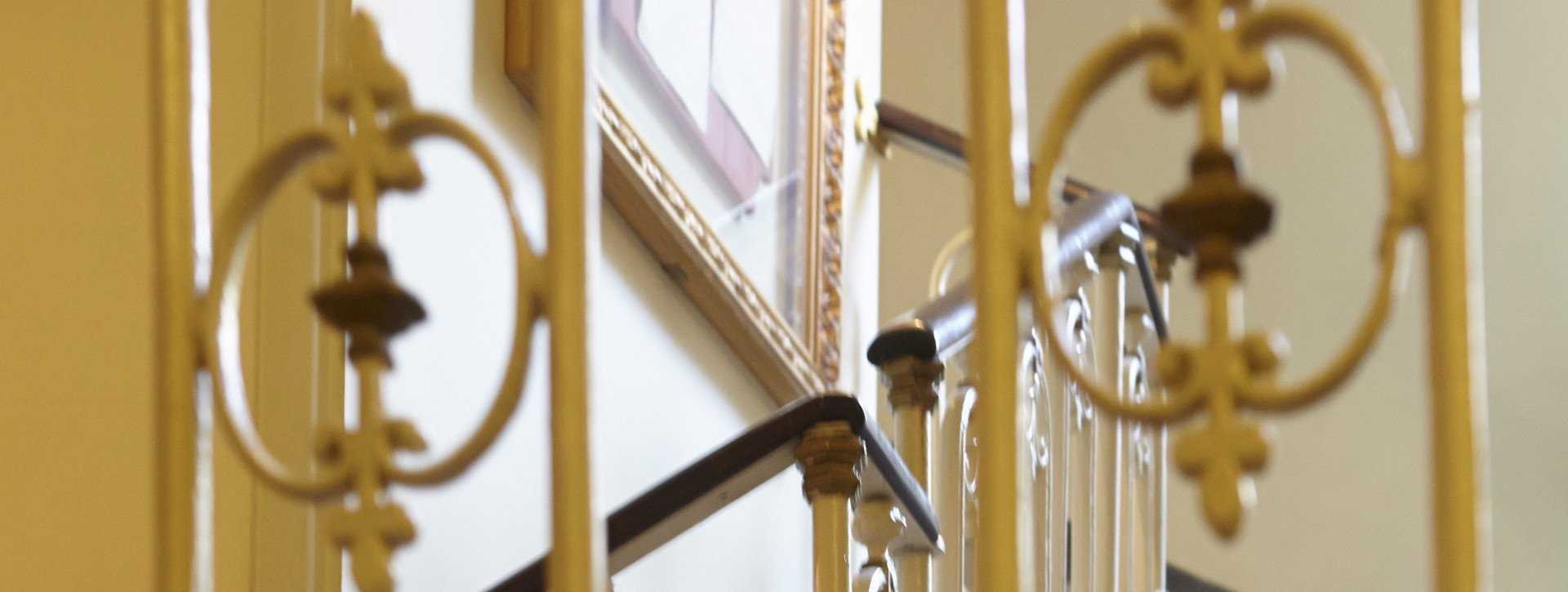 Golden stairwell in International au Lac Historic Lakeside Hotel